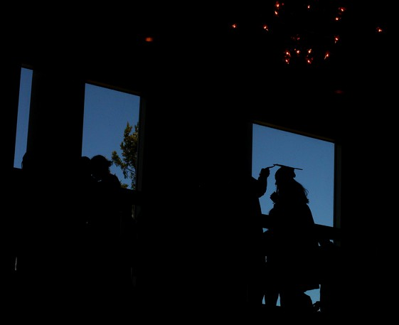 A Mount Allison University graduate gets help with her tassel in this file photo.