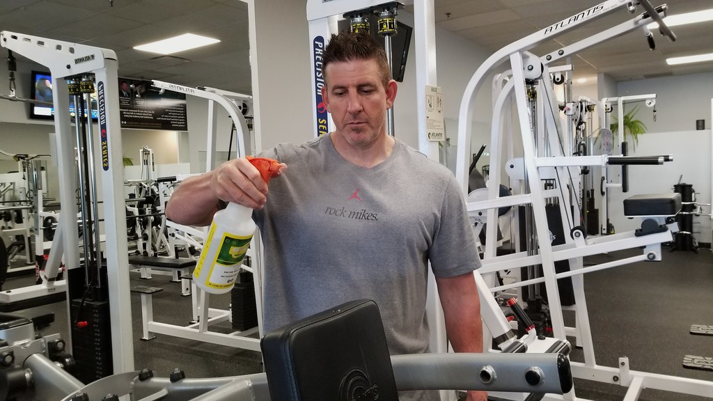 Full Body Fitness owner Derek Wilson sanitizes equipment as the gym prepared to reopen in June after being closed for three months due to the COVID-19 pandemic. Gyms and fitness facilities are closed again with the province's return to the red phase.