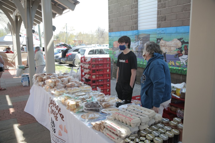 Blaine Allen, left, and Augustus Smith sold baked goods at the market last year.