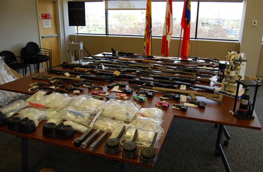 In late May, police said they seized 53 firearms as well as drugs and money from a home in Lake George after a suspicious fire destroyed two vehicles in the driveway.