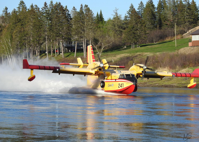 A water bomber lands in the river in Barnettville in May, when crews battled a forest fire near Blackville, south of Miramichi. So far this year, the Department of Natural Resources and Energy Development has called in aircraft from Quebec and Newfoundland to help suppress fires.