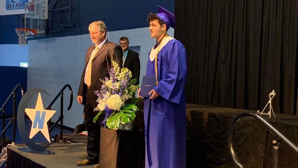CNHS graduate Ramzy Hagan receives his diploma and poses for a photo with principal Jason Smith.