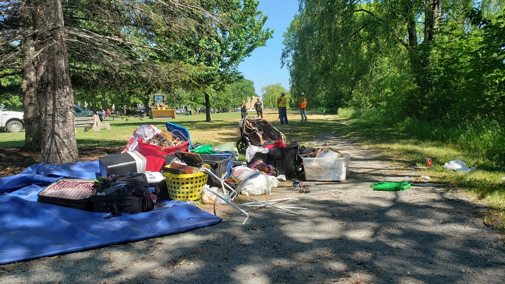 A pile of belongings from a homeless camp were removed by the city near the Bill Thorpe Walking Bridge on June 22.