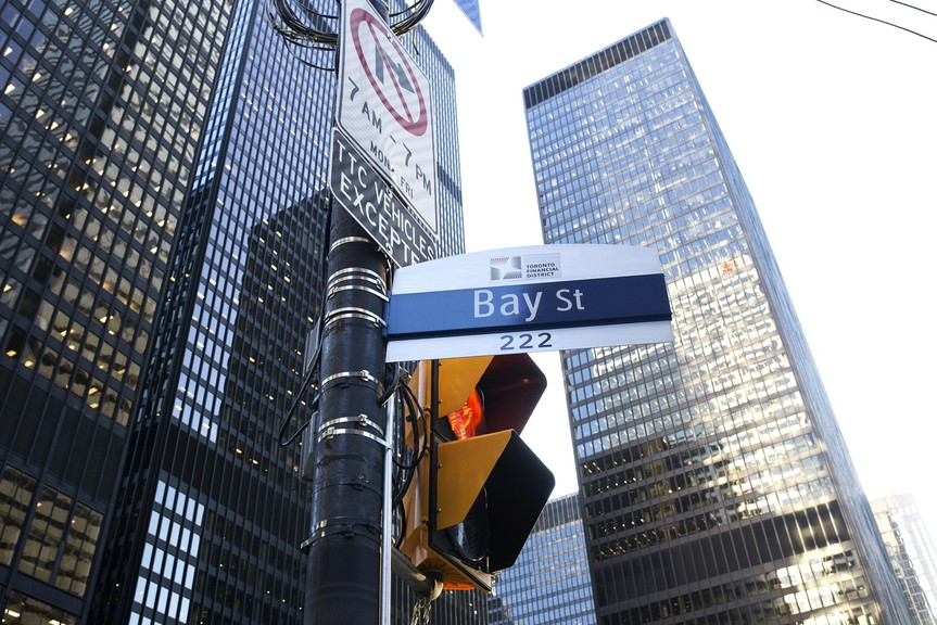 A Bay Street sign is displayed in the financial district of Toronto on Feb. 21, 2020.