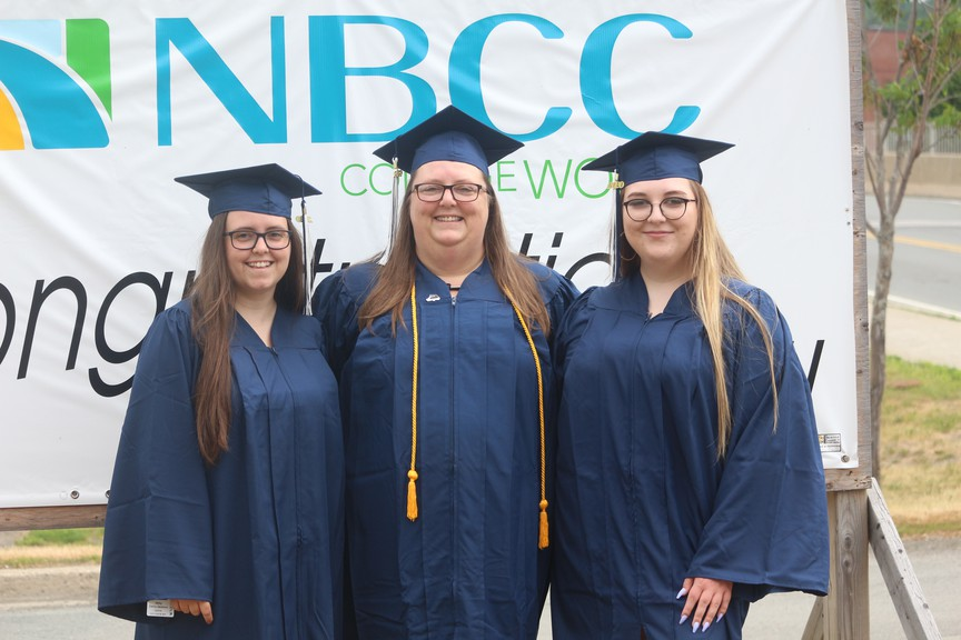 Abby Cerro-Jackson, left, and Ciara Sears,right, graduated from NBCC Woodstock with their mom, Angela Sears, middle, on June 26.