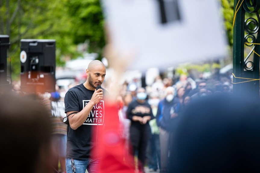 Matthew Martin, the founder and president of Saint John Black Lives Matter Movement, addresses the crowd at a recent anti-racism rally in Saint John. He and Ralph Thomas are set to meet with Premier Blaine Higgs Wednesday.