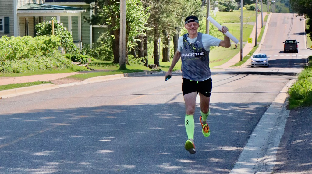 Mount Allison University president Jean-Paul Boudreau delivered diplomas to graduating students on a nearly eight-kilometre run throughout Sackville last week.
