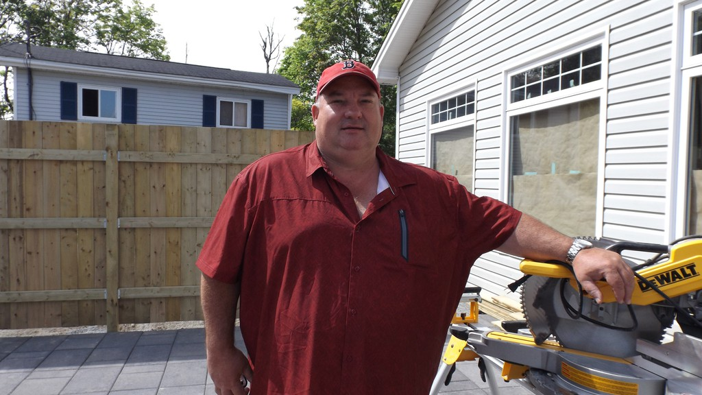 Steve Walton, owner of the Tipsy Tomato Pizzeria and Pub, stands on the new patio. The new expansion is expected to open two to three weeks.
