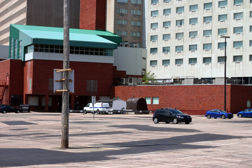 A parking lot normally filled with downtown workers is nearly empty on Friday.