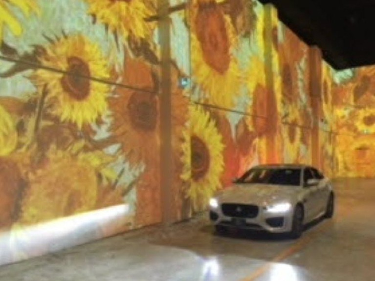 A car makes its way through the Immersive Van Gogh art exhibit in Toronto.