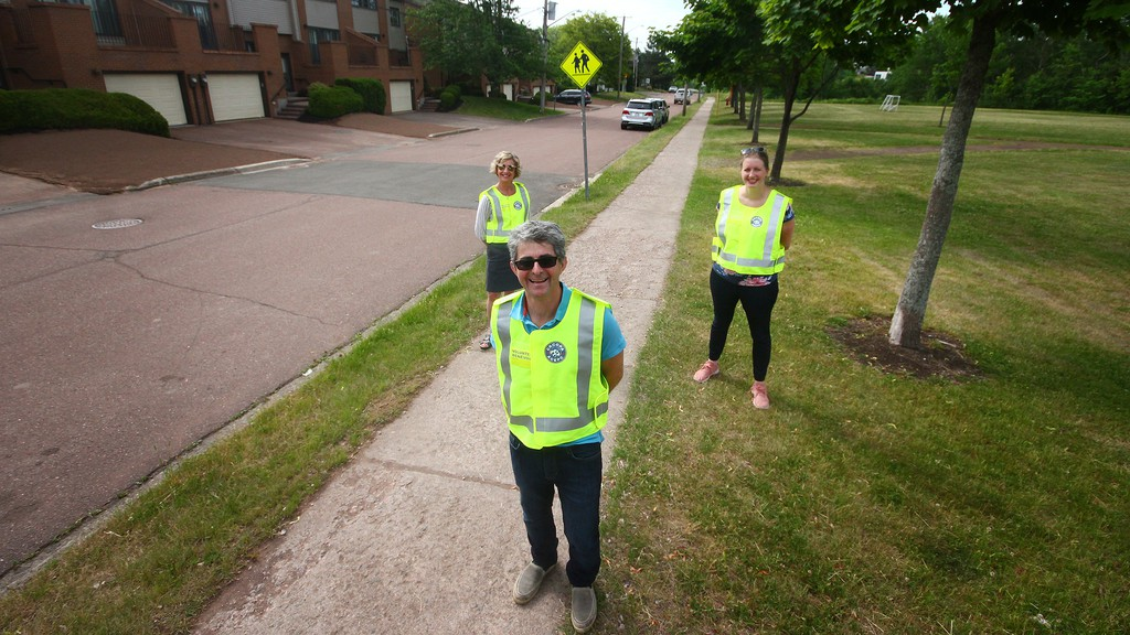 From left, Codiac Regional Citizens on Patrol Association members Sue Craig, Paul Moores and Leah Musgrove are photographed near Hillcrest School on the weekend. The group is looking for volunteers to sign on to the group.