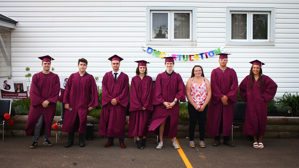 The so-called 'Times & Transcript babies;' eight Lutes Mountain Church of the Nazarene graduates who were born within months of each other 18 years ago, recreate a photo that appeared in the newspaper in 2002. From left are: Hayden Brown, Isaac Carter, Morgan Hicks, Lia Williams, Ethan Duart, Isabella DesRoche, Cory Steeves and Isabella Pollio