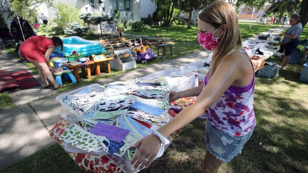 Tammy Chaplin (centre) and her crew had thousands of masks available during a block-long yard sale on Warsaw Avenue in Winnipeg last week.