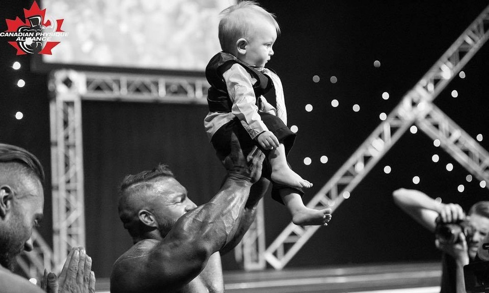 Flex Lewis holds up Hunter Nelson, grandson of show promoter Heather LeBlanc, at the 2018 Flex Lewis Canadian Classic. The 2020 event has been cancelled due to the COVID-19 pandemic, but the New Brunswick open and natural show will be held Oct. 10 at the Delta Beausejour in Moncton.