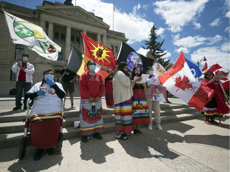 People gather at a Saskatchewan rally on Missing and Murdered Indigenous Peoples. Canadians need to confront their past and build a new relationship that takes into account the legacy of Indigenous peoples, writes Sue Rickards.