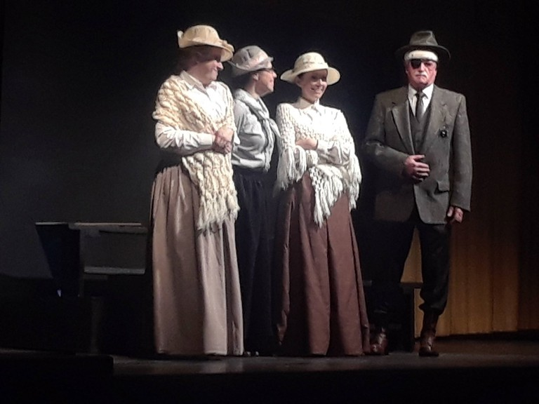 Heather Cox, Cindy Rule and Lisa Savage play three rum-running ladies opposite Billy Young as Officer Menzies in a local theatre production at the Vogue theatre in 2018. The Miramichi was divided over the Scott Act which legislated prohibition at the end of the 19th century.