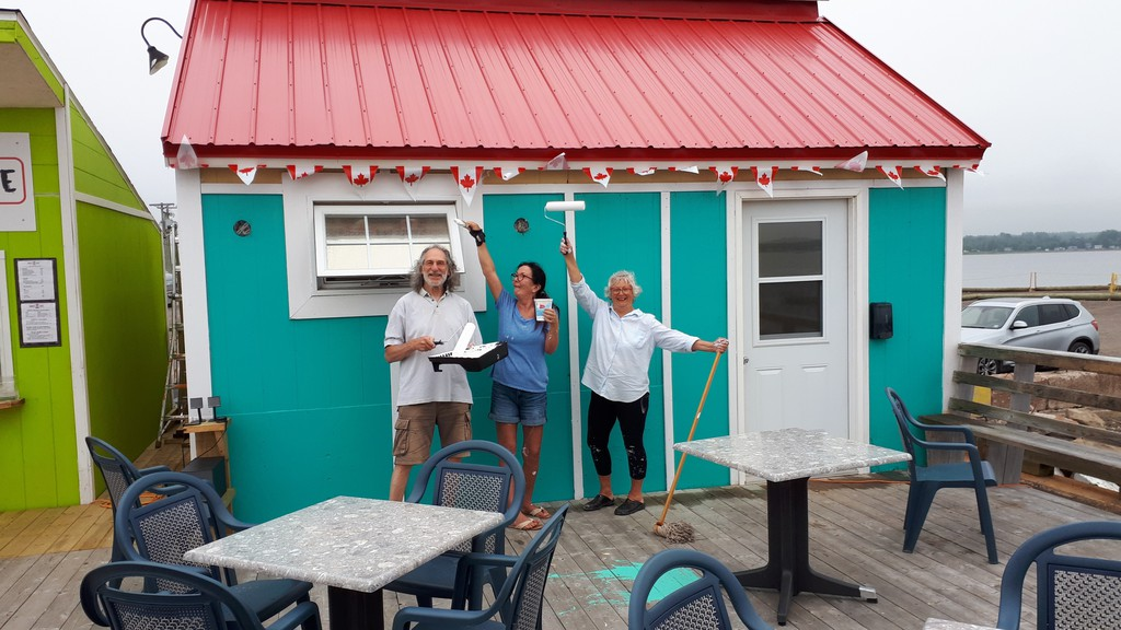 ArtShediac members Zev Bagel, Amy McKay and Susan Jardine put the finishing touches on painting their new art gallery located on the Pointe-du-Chêne Wharf.