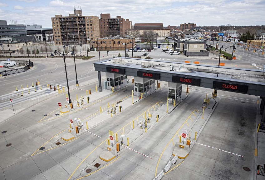 The United States and Canada agreed to close the border to nonessential traffic in March. The majority of customs lanes at the Detroit-Windsor Tunnel are closed in this April photo; the restrictions have been extended until at least July 21.