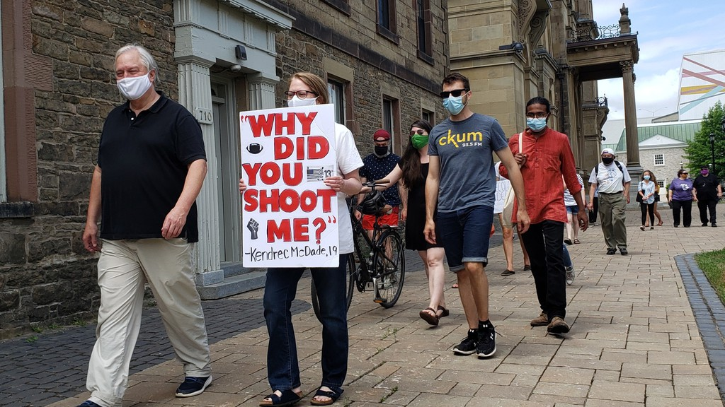 A small group of about 20 people took part in a March for Healing in Fredericton on Canada Day from the provincial legislature to city hall.