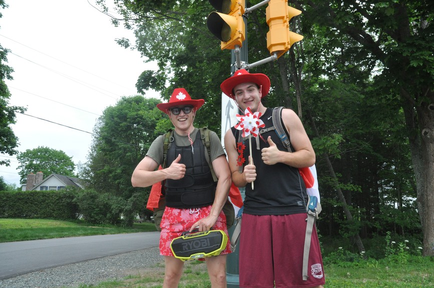Taylor Ramljack and Tom Matchett were out for a Canada Day-themed walk on Gondola Point Road in Quispamsis on Wednesday. They were playing up-beat music on a stereo as they walked.