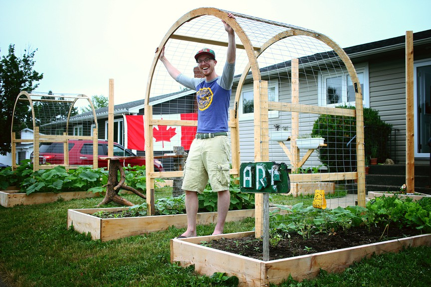 Sylvain Ward and the garden he built in the front yard of his Sunny Brae home. After initially telling Ward he'd have to tear it down, City of Moncton officials said Tuesday they are reviewing their policy on front-yard gardens.