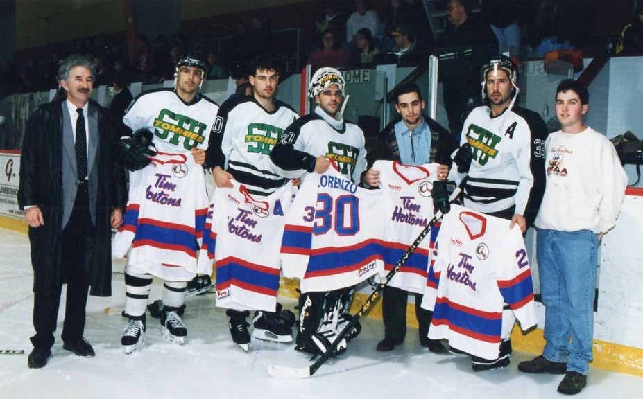 This photo from the 1995-96 AUS men's hockey conference season shows the STU Tommies choices for the all-star game. They include, from left, coach Al MacAdam, Patrick Cloutier, Ryan Black, Johnny Lorenzo, Matt Hogan, Eric Bissonnette and an unidentified Tim Hortons rep.