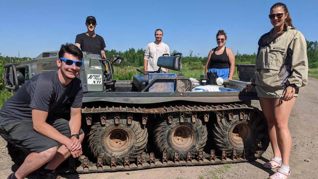 Supervisors and mosquito technicians from the Greater Moncton Pest Control Commission pose for a team photo in front of one of their Argos. From left, Robert Gallant, Sasha Leger, Lachlan Thornton, Maija LaPierre and Emma Pleshka.