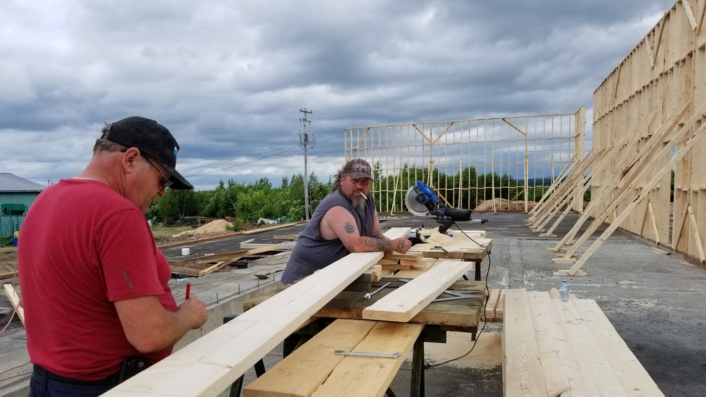 Tony Ruff, left and Wade Giggie, W. F. Tompkins and Sons Ltd. workers, are helping to rebuild the Bath sawmill facility that was destroyed in a May 25 fire. The owner hopes to have the facility operating in September.