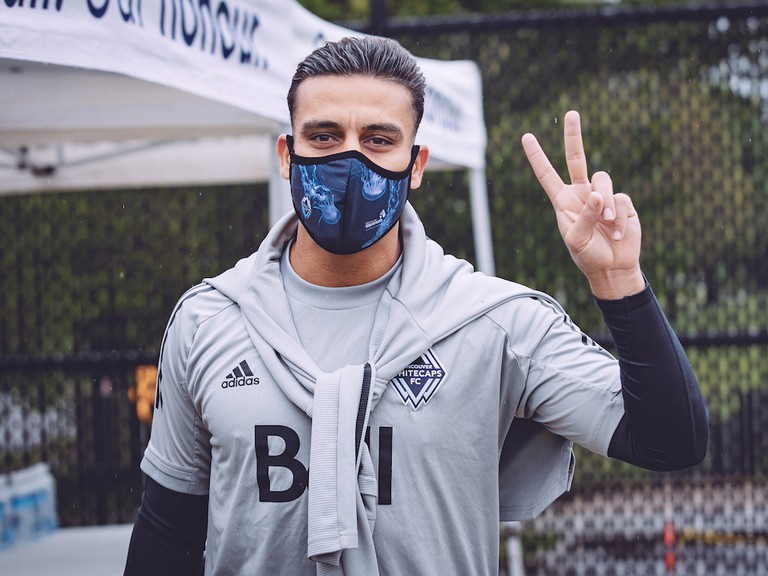 Vancouver Whitecaps left back Ali Adnan gives his sign of approval after arriving for training at the team's UBC practice facility in May.