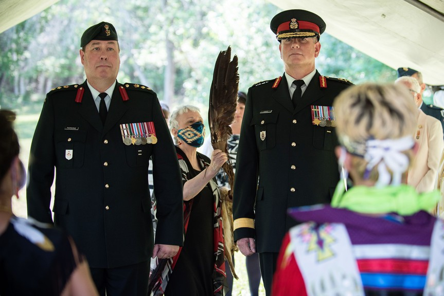 Col. Dwayne Parsons, left, incoming commander of Base Gagetown, and Brig.-Gen. Keith Osmond, outgoing commander of Base Gagetown, participate in an Indigenous ceremony involving smudging, prayer and song prior to the a change of command ceremony Thursday at Base Gagetown.