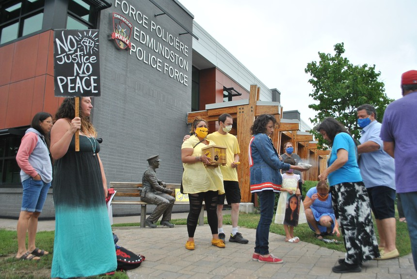 Protesters rally outside the Edmundston Police Department Friday at noon decrying a decision to reinstate police officer to administrative duty who was involved in shooting death of Indigenous resident Chantel Moore.