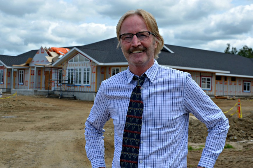 Dr. Gerard Losier, a Miramichi physician and philanthropist, stands in front of Hospice Miramichi's new residential hospice building. The project is being sponsored by the Dr. Gerard and Judy Losier Family Foundation.