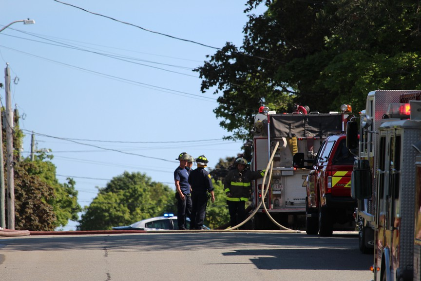 Firemen entered the building by forced entry into the basement and extinguished the small fire.