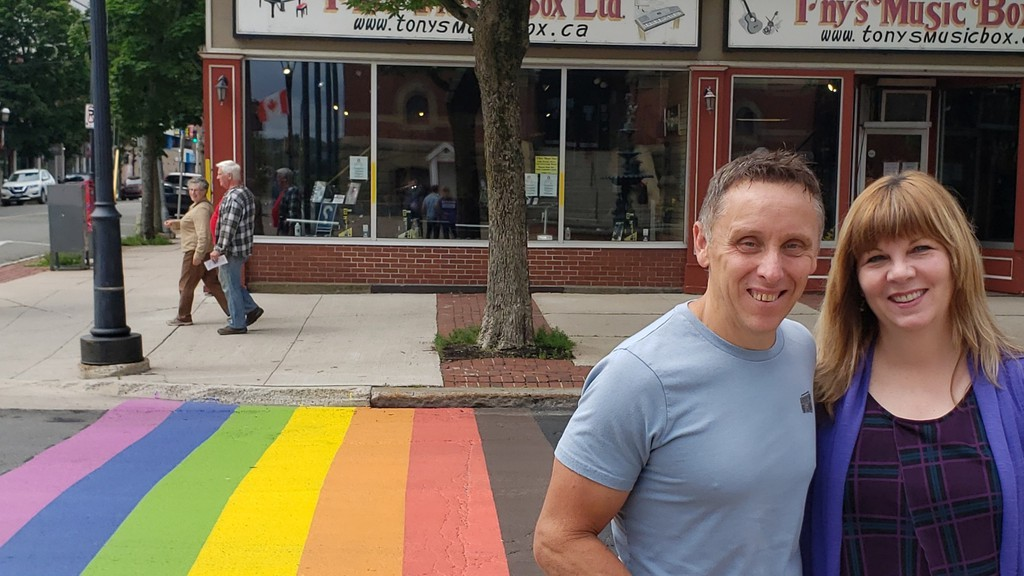Shawn and Jill Brideau of Lincoln admire the new rainbow crosswalk, complete with two new colours this year, on Queen Street in downtown Fredericton Sunday morning.
