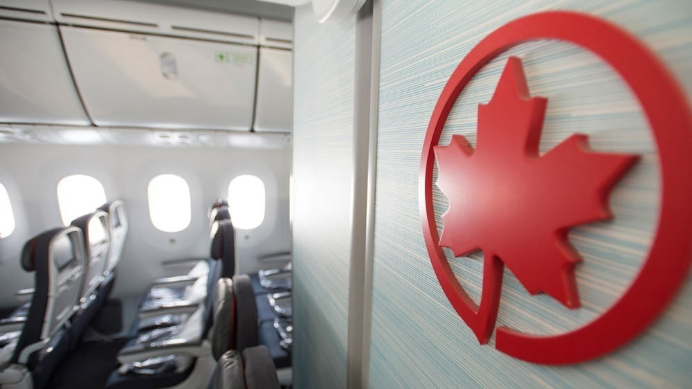 "Keeping middle seats empty during flights was ""intended as a temporary measure,"" Air Canada said in a statement."