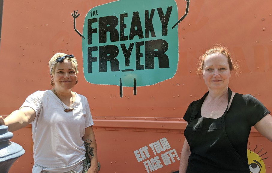 Chef Kelly Dupuis and owner Julie Chapman stand in front of the Freaky Fryer food truck. The truck will be located in the parking lot of Moncton's Treitz Haus all summer long.