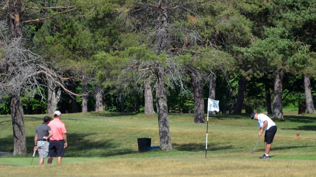 Golfers take part in the Bud Colwell Two-Man Scramble at the Woodstock Golf and Curling Club on Saturday, July 4.