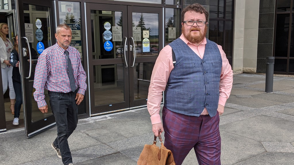 Donald Kyle (left) and lawyer Mathieu Boutet leave the Moncton Law Courts on Monday after the Crown withdrew a manslaughter charge against Kyle.