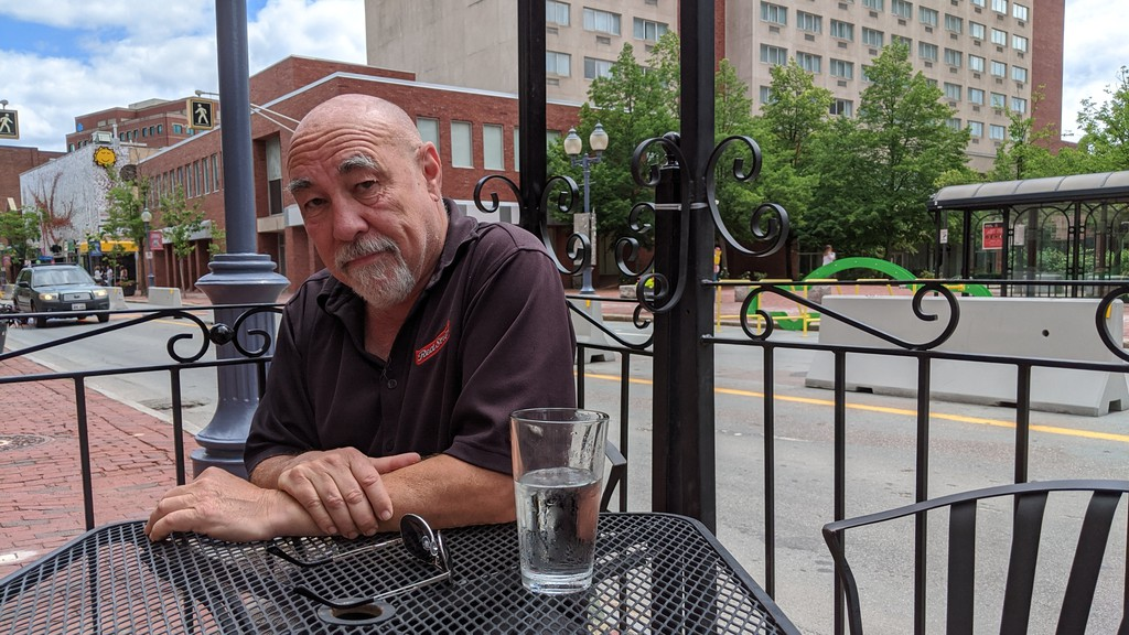 Old Triangle owner Steve Gallagher sits at one of the tables on his second patio. The pub recently expanded their patio to accommodate more patrons.