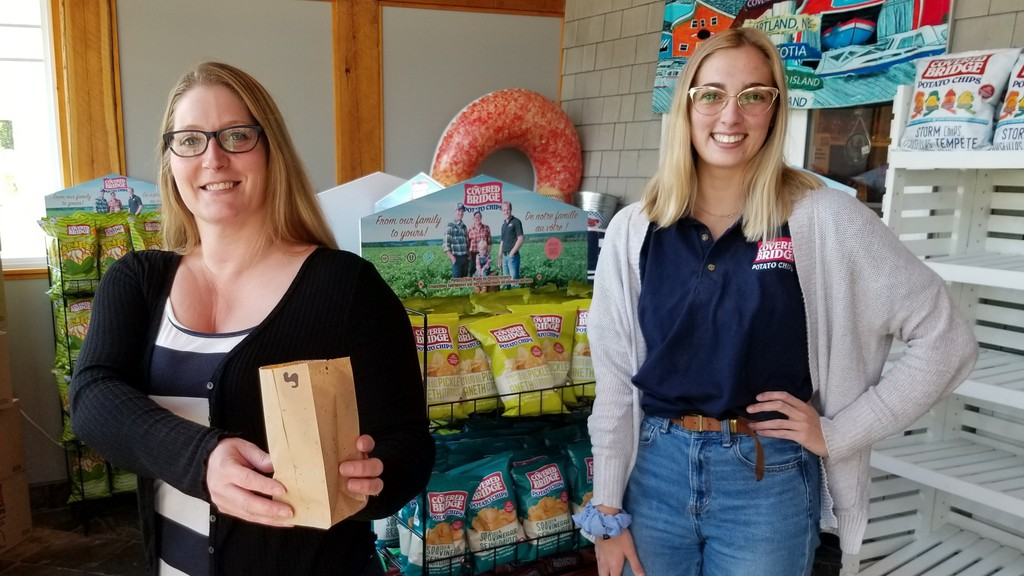 Dolina Walker, Covered Bridge Chips gift shop supervisor, and Elle Culberson, gift shop employee at the Waterville factory store. Covered Bridge Chips and BontéFoods Limited of Dieppe have teamed up to create a fried pepperoni chip inspired by Chris Brothers pepperoni.