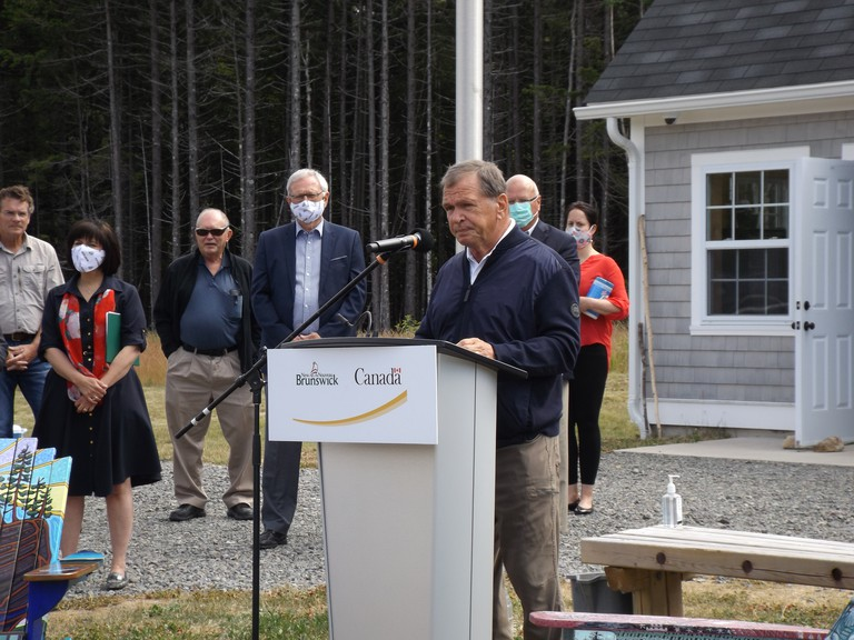 Frank McKenna, former New Brunswick premier, speaks at the official opening of the updated Fundy Trail Parkway on Tuesday.