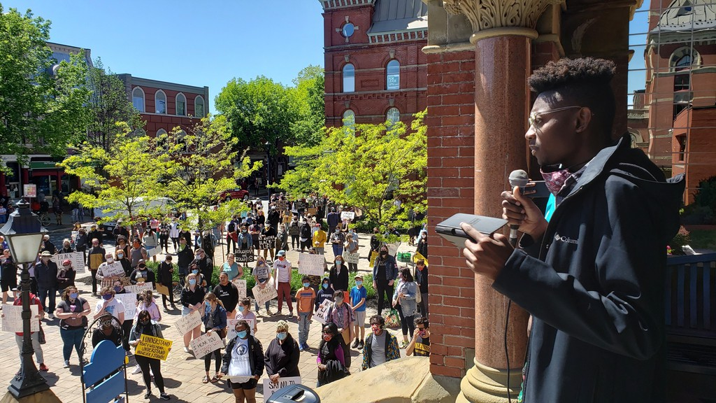 Black Lives Matter Fredericton spokesperson Husoni Raymond, seen here in this file photo addressing a BLM protest in Fredericton in June, says his organization was disappointed New Brunswick Premier Blaine Higgs didn't responded to a week-old request for a meeting until he called them out on social media.