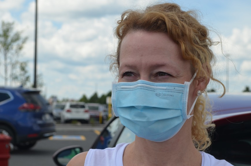 Carol Illsley, pictured outside the Fredericton uptown Sobeys, wears a mask to protect others in the community.