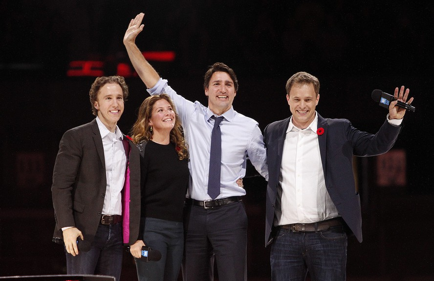 Prime Minister Justin Trudeau and his wife Sophie Gregoire-Trudeau are flanked by We Day co-founders Craig Kielburger, left, and Marc Kielburger, right.