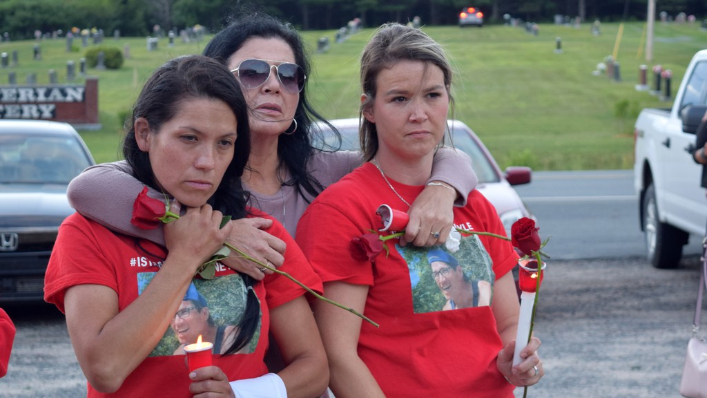 Rodney Levi's sisters Jaime Levi and Linda Levi, and niece Becky Levi at Sunday's Candle Light Prayer ceremony at Boom Road Pentecostal Church.