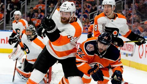 Philadelphia Flyers forward Sean Couturier of Bathurst, left.