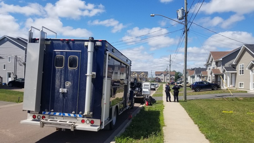 Officers from the RCMP's explosives disposal unit help execute a search warrant at a home on Clarendon Drive on Thursday, July 16, 2020. A man was charged with more than a dozen offences in relation to the incident.