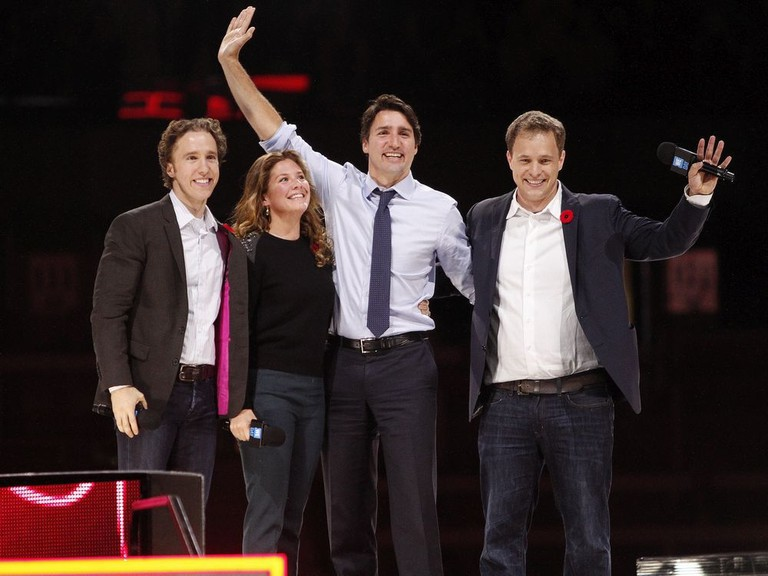 Canada's Prime Minister Justin Trudeau and his wife Sophie Gregoire-Trudeau are flanked by We Day co-founders Craig Kielburger, left, and Marc Kielburger, right.