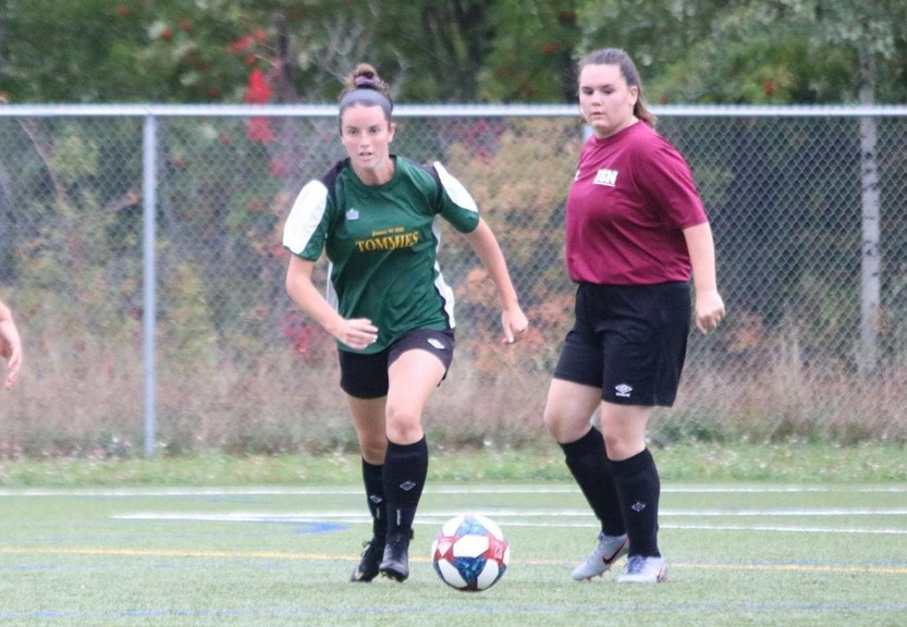 Julianne MacCallum, left, shown in action with the James M. Hill Tommies girls' soccer squad. MacCallum will join the University of New Brunswick Saint John Seawolves women's team when post-secondary sports resume.