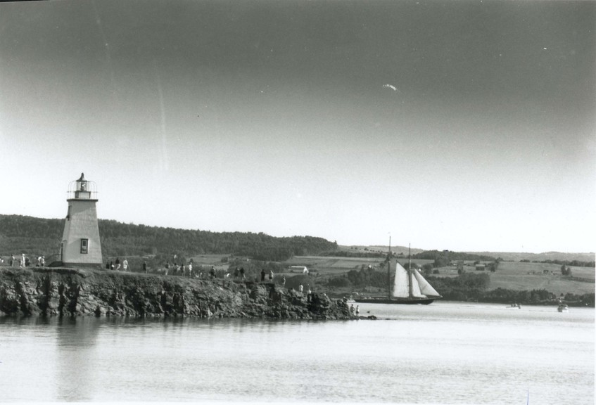The Bluenose II passes the lighthouse.
